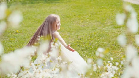 Happy-Cute-Girl-7-8-Years-Old-Whirling-In-A-White-Dress-On-The-Grass-Slow
