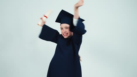 Happy-Graduate-Girl-7-8-Years-In-The-Mantle-And-Hat-Holding-Diploma