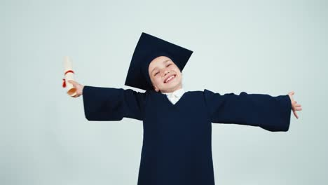 Happy-Graduate-Girl-7-8-Years-In-The-Mantle-And-Hat-Holding-Diploma-On-White