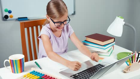 Happy-Schoolgirl-And-Unhappy-Child-78-Years-Something-Typing-In-Laptop