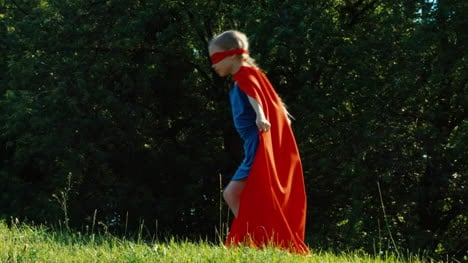 Happy-Superhero-7-8-Years-Old-Running-Against-The-Blue-Sky