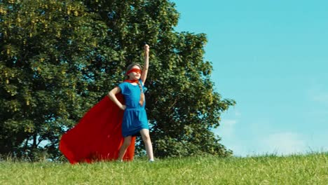 Happy-Superhero-Girl-Child-7-8-Years-Old-Running-Against-The-Blue-Sky