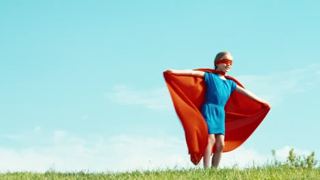 Happy-Superhero-Girl-Child-7-8-Years-Old-Spinning-Against-The-Blue-Sky