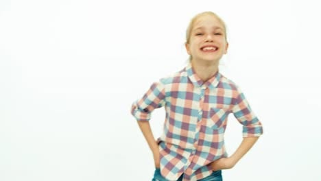 Laughing-Girl-Child-On-The-White-Background-And-Smiling-At-Camera