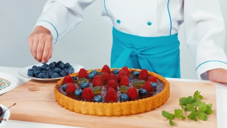 Little-Chef-Cook-Decorating-The-Cake-Using-Blueberry