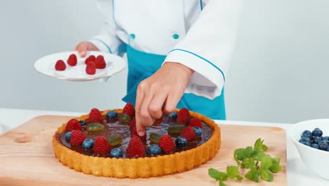 Little-Chef-Cook-Decorating-The-Cake-Using-Raspberries