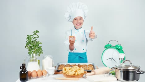 Little-Chef-Cook-Girl-Child-7-8-Years-Old-Holding-Biscuit-And-Smiling-At-Camera