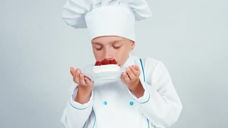 Little-Chef-Holds-In-Hands-Biscuit-Cake-Sniffing-And-Gives-You