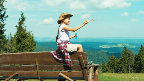 Little-Hiker-Girl-7-8-Years-Old-Playing-With-Soap-Bubbles