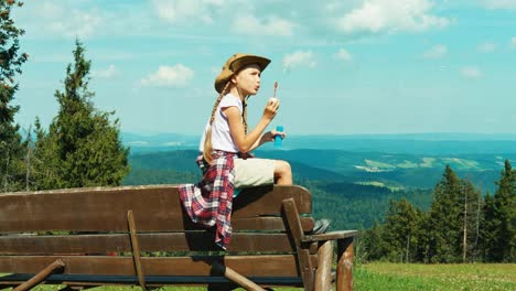 Little-Hiker-Girl-Child-7-8-Years-Old-Blowing-Soap-Bubbles-And-Sitting-On-Bench