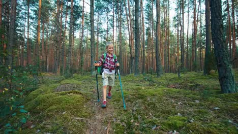 Little-Hiker-Girl-Child-Walking-In-Forest-At-Camera