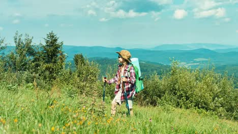 Little-Hiker-Girl-In-Sunglasses-With-Backpack-Going-Up-The-Hill-On-Mountains
