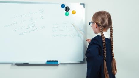 Little-Student-Holding-Pointer-Standing-Near-Whiteboard-Thumb-Up-Ok