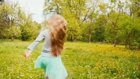Portrait-7-8-Years-Old-Girl-In-Blue-Skirt-Spinning-In-The-Park-In-The-Spring