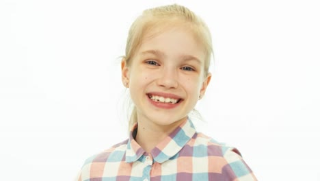 Portrait-7-8-Years-Old-Girl-In-The-Shirt-Standing-On-The-White-Background