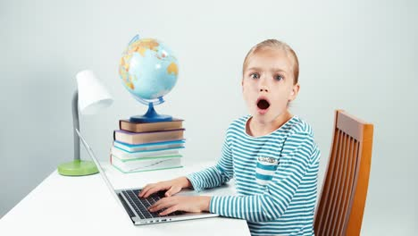 Portrait-7-8-Years-Schoolgirl-Using-Laptop-And-Smiling-At-Camera-Girl-Isolated
