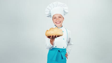 Portrait-Baker-Holds-Round-Bread-In-Her-Hands-And-Gives-You-Smiling-At-Camera