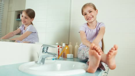 Portrait-Blonde-Child-Girl-7-8-Years-Sitting-In-The-Bathroom
