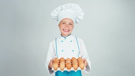 Portrait-Chef-Cook-Girl-7-8-Years-Holds-Egg-Tray-And-Smiling-At-Camera-Isolated