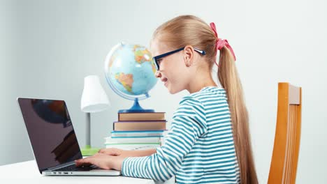 Portrait-Child-7-8-Years-Old-Something-Typing-On-Her-Laptop-And-Laughing