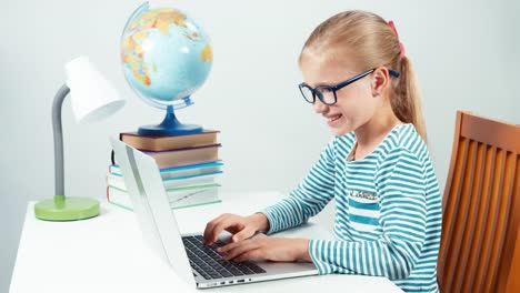 Portrait-Child-7-8-Years-Old-Something-Typing-On-Her-Laptop-And-Smiling