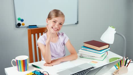 Portrait-Child-7-8-Years-Raises-His-Hand-Up-Student-Sitting-In-Her-Desk