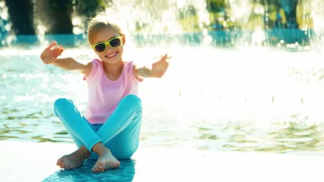 Portrait-Child-Girl-7-8-Years-In-Sunglasses-Sitting-Relaxing-Near-Fountain