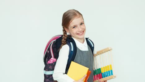 Portrait-Cute-Happy-Schoolgirl-Child-7-8-Years-With-Backpack-Holding-Abacus