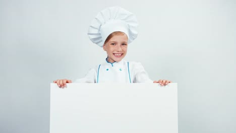 Portrait-Cute-Little-Chef-Cook-In-Cap-With-White-Board-Isolated-On-White-Smiling
