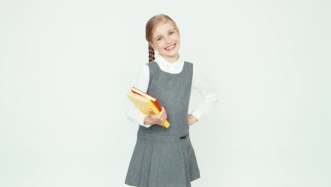 Portrait-Cute-Schoolgirl-7-8-Years-Holding-Books-On-White-Background