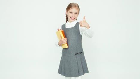 Portrait-Cute-Schoolgirl-7-8-Years-Holding-Books-Turns-Around-At-Camera
