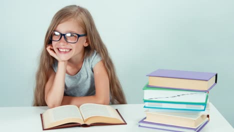 Portrait-Cute-Student-Girl-7-8-Years-Reading-Book-And-Smiling-Away