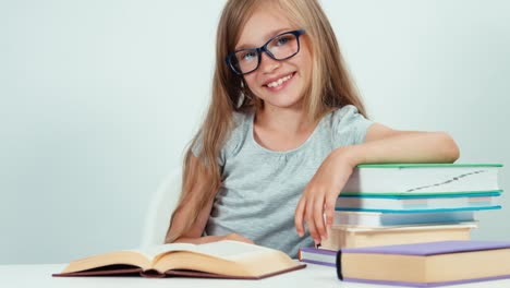 Portrait-Foureyes-Schoolgirl-7-8-Years-Reading-Book-At-The-Table-On-White