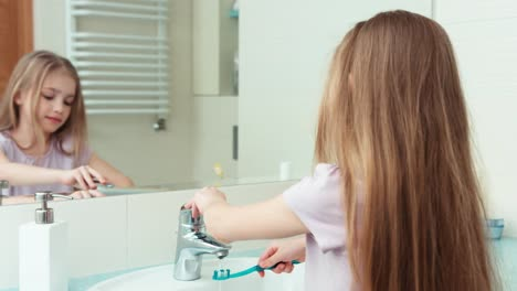Portrait-Girl-7-Years-Old-Brushing-Her-Teeth-With-A-Toothbrush