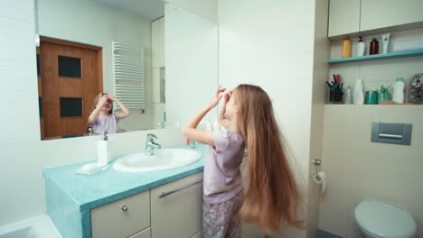 Portrait-Girl-7-Years-Old-Preening-Long-Beautiful-Hair-Before-The-Mirror