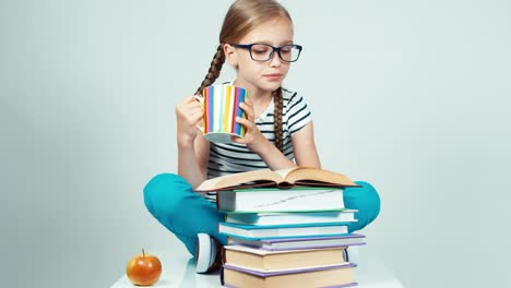 Portrait-Girl-7-8-Years-Old-Reading-Book-And-Drinking-Tea
