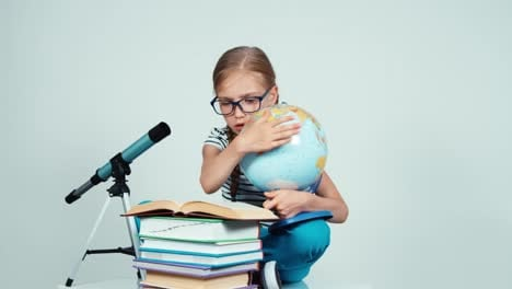 Portrait-Girl-7-8-Years-Old-Reading-Book-And-Holding-Her-School-Globe
