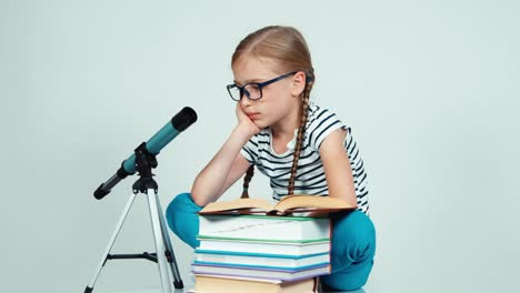 Portrait-Girl-7-8-Years-Old-Reading-Book-Near-Telescope