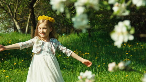 Portrait-Girl-7-8-Years-Spinning-In-The-White-Dress-In-Park-Near-Blooming-Tree