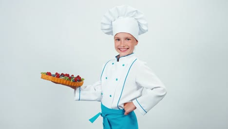 Portrait-Girl-7-8-Years-Young-Chef-Cook-Holds-Cake-Handmade-Smiling-At-Camera