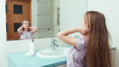 Portrait-Girl-Child-7-Years-Old-Preening-Before-The-Mirror-In-The-Bathroom