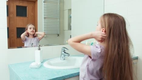 Portrait-Girl-Niño-7-Years-Old-Preening-Before-The-Mirror-In-The-Bathroom