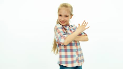 Portrait-Girl-Dancing-On-The-White-Background-And-Smiling-At-Camera