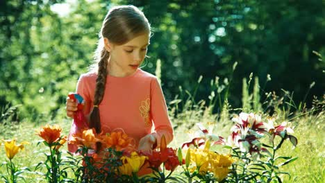 Portrait-Girl-Sprinkler-Her-Flowers-In-The-Garden-And-Sniffing-Their