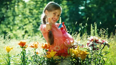 Portrait-Girl-Sprinkler-Her-Flowers-In-The-Garden-Thumb-Up-Ok