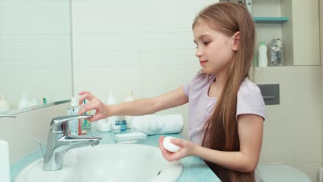 Portrait-Girl-Washing-Hands-With-Soap-In-Bathroom