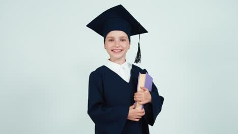 Portrait-Graduate-Girl-7-8-Years-In-The-Mantle-And-Hat-Holding-Her-Book