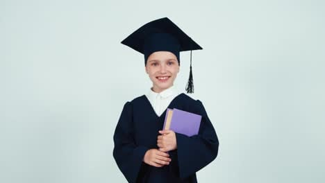 Portrait-Graduate-Girl-7-8-Years-In-The-Mantle-And-Hat-Turns-Around-At-Camera