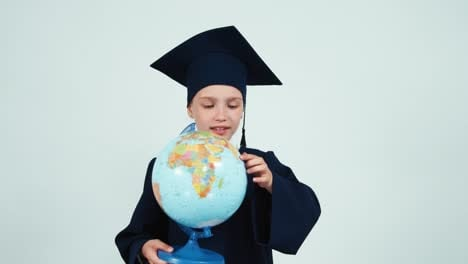 Portrait-Graduate-Girl-7-8-Years-In-The-Mantle-Holding-Globe-On-White-01