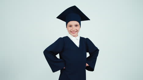 Portrait-Happy-Graduate-Girl-7-8-Years-In-The-Mantle-And-Hat-Has-Power